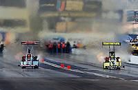 Feb. 20, 2010; Chandler, AZ, USA; NHRA top fuel dragster driver Terry McMillen (left) races alongside Morgan Lucas during qualifying for the Arizona Nationals at Firebird International Raceway. Mandatory Credit: Mark J. Rebilas-