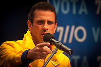 Venezuelan opposition leader Henrique Capriles Radonski speaks to the press upon the first bulletin of the electoral authority showing President Hugo Chavez winning the national election in this oil rich country