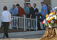 Pallbearers carry the casket of Sago miner Fred Ware into the Sago Baptist church near Buckhannon, WV, Monday, Jan. 9, 2006, for his wake.  Ware is one of the 12 miners killed in a mine explosion at the Sago mine near the church. (Gary Gardiner/EyePush Newsphotos)..