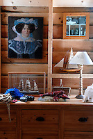 In a corner of the living room recessed lighting casts a glow over some of the vintage objects on display