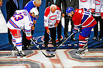 4 December 2008: Montreal Canadiens legend Henri Richard (center) drops the puck between New York Rangers' Captain Chris Drury (23) and Montreal Canadiens Captain Saku Koivu in a pre-game ceremonial faceoff between the two teams at the Bell Centre in Montreal, Quebec, Canada. The Canadiens, celebrating their 100th season, played in the circa 1915-1916 uniforms for the evenings' Original Six matchup. The Canadiens defeated the Rangers 6-2. *****Editorial Use Only*****..Mandatory Photo Credit: Ed Wolfstein Photo