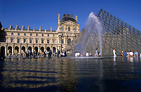 Courtyard and the Louvre Pyramid, main entrance to the Louvre Museum, Paris, France.