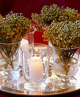 Bouquets of fresh spruce in individual glasses are used as a winter decoration