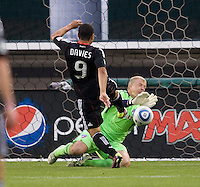 Charlie Davies (9) of D.C. United has his shot saved by Kevin Hartman (1) of FC Dallas during the game at RFK Stadium in Washington, DC.  D.C. United tied FC Dallas, 0-0.