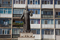 Romania. Iași County. Iasi. Town center. Old appartment buildings, called blocks, built during communist time. A man looks out of window and calls with a mobile phone. Pigeons and statue of Alexander the Good (Alexandru cel Bun in Romanian), Moldavian voivode, reigned 1400-1432. Iași (also referred to as Iasi, Jassy or Iassy) is the largest city in eastern Romania and the seat of Iași County. Located in the Moldavia region, Iași has traditionally been one of the leading centres of Romanian social and cultural life. The city was the capital of the Principality of Moldavia from 1564 to 1859, then of the United Principalities from 1859 to 1862, and the capital of Romania from 1916 to 1918. 5.06.15 © 2015 Didier Ruef