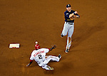 21 June 2011: Seattle Mariners shortstop Brendan Ryan gets a sliding Roger Bernadina out at second as he turns a double play against the Washington Nationals at Nationals Park in Washington, District of Columbia. The Nationals rallied from a 5-1 deficit, scoring 5 runs in the bottom of the 9th, to defeat the Mariners 6-5 in inter-league play. Mandatory Credit: Ed Wolfstein Photo