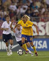 Sweden forward Josefine Oqvist (11) accelerates away from US defender Kate Markgraf (15). The US Women's national team beat Sweden, 3-0, at Rentschler Field on July 17, 2010.