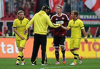 FUSSBALL   1. BUNDESLIGA  SAISON 2012/2013   2. Spieltag 1. FC Nuernberg - Borussia Dortmund       01.09.2012 Marcel Schmelzer, Trainer Juergen Klopp, Mario Goetze (v.li., Borussia Dortmund)