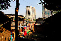 Tower apartment blocks behind the Mirpur slum in Dhaka.