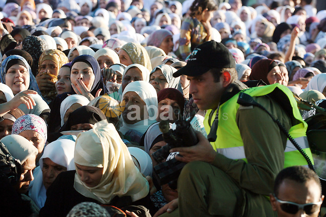 Palestinian women wait to cross the Qalandia checkpoint on their way to pray at the Al Aqsa Mosque on the third Friday of the Muslim holy month of Ramadan, at the Qalandia checkpoint between the West Bank city of Ramallah and Jerusalem, Friday, Aug. 19, 2011. Muslims around the world are observing the holy fasting month of Ramadan where they refrain from eating, drinking, smoking from dawn to dusk. Photo by Issam Rimawi