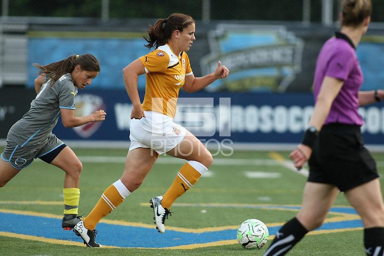 Atlanta defender, Cat Whitehill (4) carries the ball forward as Philadelphia midfielder, Christina DiMartino (5), gives chase.  The Philadephia Independence battled theAtlanta Beat to a scoreless draw on June 4th at Widener University in Chester, PA.