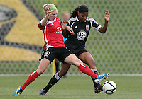 BOYDS, MARYLAND - July 21, 2012:  Tiffany Brown (9) of DC United Women goes after a loose ball with Megan Weston (16) of the Virginia Beach Piranhas during a W League Eastern Conference Championship semi final match at Maryland Soccerplex, in Boyds, Maryland on July 21. DC United Women won 3-0.