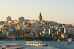 A ferry boat on the Golden Horn passes beneath the Galata Tower in Istanbul
