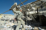 U.S. soldiers help clear the worst of the rubble in the devastated center of Port-au-Prince, Haiti, which was ravaged by a January 12 earthquake.
