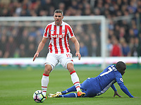 Stoke City's Jonathan Walters overcomes Chelsea's Ngolo Kante<br /> <br /> Photographer Mick Walker/CameraSport<br /> <br /> The Premier League - Stoke City v Chelsea - Saturday 18th March 2017 - bet365 Stadium - Stoke<br /> <br /> World Copyright &copy; 2017 CameraSport. All rights reserved. 43 Linden Ave. Countesthorpe. Leicester. England. LE8 5PG - Tel: +44 (0) 116 277 4147 - admin@camerasport.com - www.camerasport.com