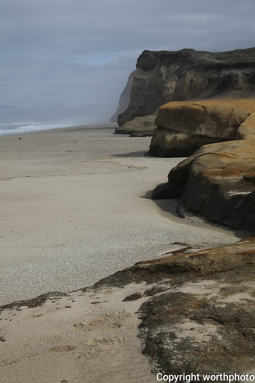 Like stepping stones rising from the sands of Pomponio State Beach - bluffs, some more eroded that others, all facing the Pacific.