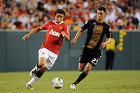 Rafael (21) of Manchester United battles Nick Zimmerman (23) of the Philadelphia Union battle for the ball. Manchester United (EPL) defeated the Philadelphia Union (MLS) 1-0 during an international friendly at Lincoln Financial Field in Philadelphia, PA, on July 21, 2010.