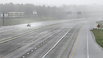 As the eye of Hurricane Dennis comes ashore at Pensacola Beach Florida, a lone traveler heads west on a desolate Interstate 10 and the the most powerful hurricane ever to strike the panahadle coast of Florida July 10, 2005.