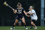 23 February 2017: Notre Dame's Casey Pearsall (24) and Elon's Bridget Lamb (right). The Elon University Phoenix hosted the University of Notre Dame Fighting Irish at Rudd Field in Elon, North Carolina in a 2017 Division I College Women's Lacrosse match. Notre Dame won the game 16-7.