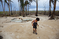 Philippines. Province Eastern Samar. Hernani. 95 % of the town was destroyed by typhoon Haiyan's winds and storm surge. A young boy plays in the sand where used to be his house. Sea of the Philippines. Pacific Ocean. Typhoon Haiyan, known as Typhoon Yolanda in the Philippines, was an exceptionally powerful tropical cyclone that devastated the Philippines. Haiyan is also the strongest storm recorded at landfall in terms of wind speed. Typhoon Haiyan's casualties and destructions occured during a powerful storm surge, an offshore rise of water associated with a low pressure weather system. Storm surges are caused primarily by high winds pushing on the ocean's surface. The wind causes the water to pile up higher than the ordinary sea level. 26.11.13 © 2013 Didier Ruef