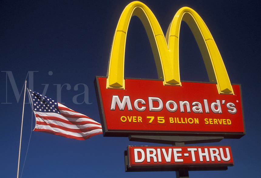 AJ2127, McDonald's, sign, Georgia, Atlanta, The U.S. flag flies next to The McDonald's restaurant sign with the golden arches.