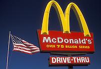 AJ2127, McDonald's, sign, Georgia, Atlanta, The U.S. flag flies next to The McDonald's restaurant sign with the golden arches.