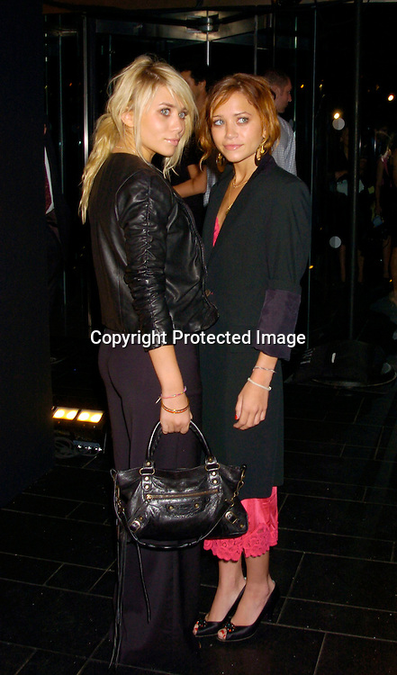 Ashley and Mary-Kate Olsen ..at Coty's 100th Anniversary Celebration  on September 12, 2004 at the  American Museum of Natural Historys Rose Center for Earth and Space ..Photo by Robin Platzer, Twin Images