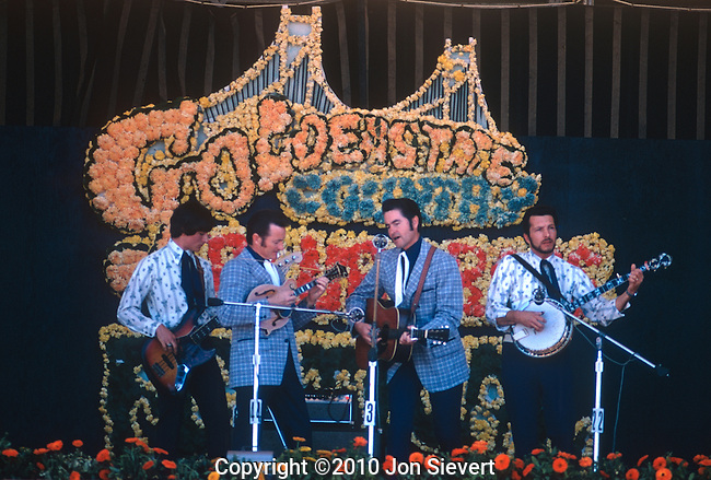 "Jim & Jesse, May 1974, Golden Gate Bluegrass Festival. American bluegrass music duo composed of brothers Jim McReynolds and Jesse McReynolds. Jesse played the mandolin with a unique, self-invented ""crosspicking"" and ""split-string"" playing method, and Jim sang as a tenor and played guitar."