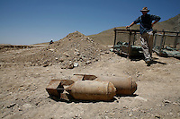 Destruction of various munitions by a Weapons and Ammunition Disposal unit from HALO Trust. Collected munitions are blown up in in a remote site. This method is used for mines, landmines, UXO's, aircraft bombs, cluster bomblets, and smaller ammunitions. © Fredrik Naumann