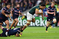 Damian de Allende of South Africa is tackled by Louis Stanfill of the USA. Rugby World Cup Pool B match between South Africa and the USA on October 7, 2015 at The Stadium, Queen Elizabeth Olympic Park in London, England. Photo by: Patrick Khachfe / Onside Images