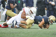 Annapolis, MD - October 8, 2016: Houston Cougars defensive end Cameron Malveaux (94) tackles Navy Midshipmen quarterback Will Worth (15) for a lost during game between Houston and Navy at  Navy-Marine Corps Memorial Stadium in Annapolis, MD.   (Photo by Elliott Brown/Media Images International)