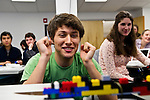 02/23/2011 - Medford/Somerville, Mass. Michael Motola-Barnes, E11, cheers as his LEGO bridge holds yet another D-battery during Engineering Week at Tufts University on February 23, 2011.  (Alonso Nichols/Tufts University)