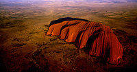 AERIAL OVER AYERS ROCK AND DESERT