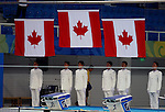 Three Canadian flags rise over the National Aquatic Centre after Canada swept the medals in women's 200 metre individual medley at the swimming finals at the Paralympic Games in Beijing, Friday, Sept., 12, 2008.    Photo by Mike Ridewood/CPC