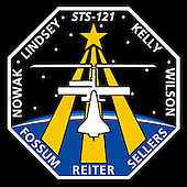 Houston, TX - June 1, 2005 -- The STS-121 patch depicts the Space Shuttle docked with the International Space Station (ISS) in the foreground, overlaying the astronaut symbol with three gold columns and a gold star. The ISS is shown in the configuration that it will be in during the STS-121 mission. The background shows the nighttime Earth with a dawn breaking over the horizon. STS-121, ISS mission ULF1.1, is the final Shuttle Return to Flight test mission. This utilization and logistics flight will bring a multipurpose logistics module (MPLM) to the ISS with several thousand pounds of new supplies and experiments. In addition, some new orbital replacement units (ORUs) will be delivered and stowed externally on ISS on a special pallet. These ORUs are spares for critical machinery located on the outside of the ISS. During this mission the crew will also carry out testing of Shuttle inspection and repair hardware, as well as evaluate operational techniques and concepts for conducting on-orbit inspection and repair..The NASA insignia design for Shuttle space flights is reserved for use by the astronauts and other official use as the NASA Administrator may authorize. Public availability has been approved only in the form of illustrations by the various news media. When and if there is any change in this policy, which is not anticipated, such will be publicly announced..Credit: NASA via CNP