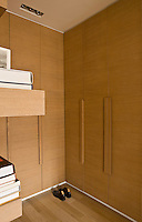 The discreet dressing room is lined with built-in oak cupboards