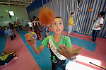 Boys learn circus skills, including juggling, as part of a psycho-social program run by Finn Church Aid in the Zaatari refugee camp near Mafraq, Jordan. Established in 2012 as Syrian refugees poured across the border, the camp held more than 80,000 refugees by early 2015, and was rapidly evolving into a permanent settlement. Finn Church Aid is a member of the ACT Alliance, which provides a variety of services to refugees living in the camp.
