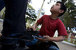Kevin, 11 years old, shines shoes in Chimaltenango, far from his parents and home in Quetzaltenango. Poor Guatemalan children are often sent off to bring in money for families that cannot afford to feed them. Kevin said he has never been to school.
