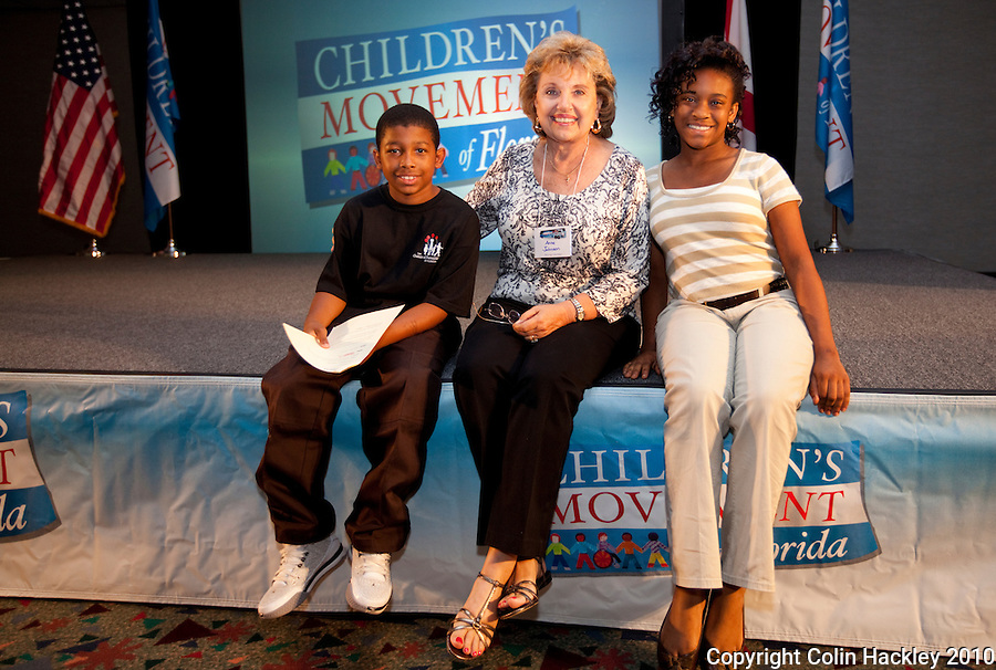 TALLAHASSEE, FLA. 9/7/10-MILK PARTY 090710 CH-Khalib Coleman, left, M/C Ana Johnson and Harbaria Gardner prior to the Children's Movement of Florida Milk Party Tuesday night in Tallahassee...COLIN HACKLEY PHOTO