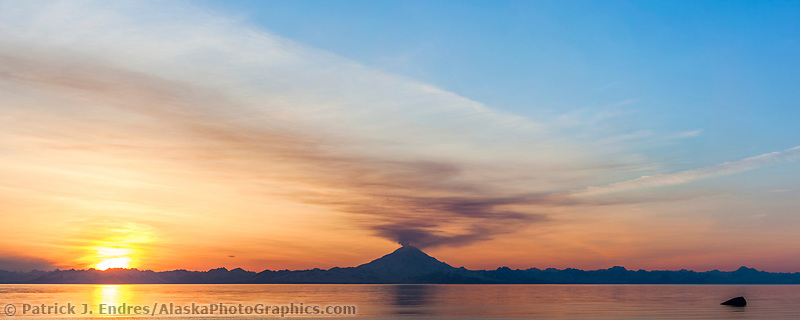 Panorama of plume of gas and vapor vent from the summit of Mt. Redoubt volcano (10,191 ft), of the Chigmit mountains, Aleutian range. View across Cook Inlet approximately 50 miles, at sunset, southcentral, Alaska.
