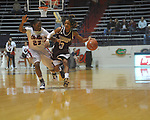 "Mississippi State's Carnecia Williams (23) drives against Ole Miss' Latosha Laws (23) in a NCAA women's college basketball game at the C.M. ""Tad"" Smith in Oxford, Miss. on Thursday, February 10, 2011.  Mississippi State won 59-43.."