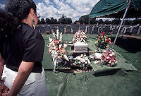 Funeral of Baby Hope on July 23, 1993 in St. Raymond's Cemetery in the Bronx in New York. Baby Hope was an abandoned child never identified found on the side of the West Side Highway, DOA in an ice cooler on July 23, 1991. The detectives from the 34th Precinct organized and paid for the funeral of the 5 year old two years after her body was found. (© Frances M. Roberts)