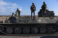 Ukrainian soldiers stand on APC preparing for departure of the convoy during the withdrawal of heavy weapons. Near Artemovsk, Eastern Ukraine. Friday, 27 February 2015.