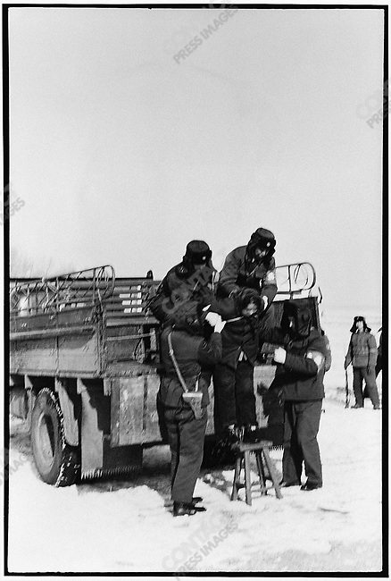 Wang Shouxin is unloaded onto a snowy field thirty kilometers southeast of Harbin and waits for her death sentence to be carried out. Outskirts of Harbin, 8 February 1980