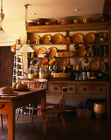 A pine dresser in this kitchen displays a collection of earthenware, much of it French country pottery