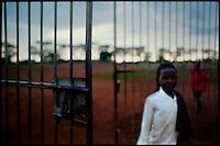 Near Gulu, Northern Uganda, June 2005.Night commuting children entering Noa's Ark shelter at dusk.