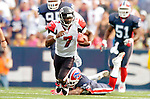 25 September 2005: Michael Vick (7), Quarterback for the Atlanta Falcons, gains 14 yards in a keeper play against the Buffalo Bills. The Falcons defeated the Bills 24-16 at Ralph Wilson Stadium in Orchard Park, NY.<br /><br />Mandatory Photo Credit: Ed Wolfstein.