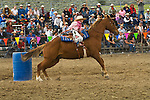 Young miss Hattie May Mort rides her horse in the Girls' barrel racing at the Jordan Valley Big Loop Rodeo