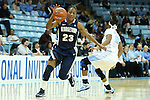 14 November 2012: Georgetown's Samisha Powell (23) spins away from North Carolina's Brittany Rountree (11). The University of North Carolina Tar Heels played the Georgetown University Hoyas at Carmichael Arena in Chapel Hill, North Carolina in an NCAA Division I Women's Basketball game, and a semifinal in the Preseason WNIT. UNC won the game 63-48.