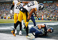 Mike Mitchell #23 of the Pittsburgh Steelers checks on Jimmy Graham #88 of the Seattle Seahawks after an incomplete pass in the end zone in the second half before Graham left with a knee injury during the game at CenturyLink Field on November 29, 2015 in Seattle, Washington. (Photo by Jared Wickerham/DKPittsburghSports)